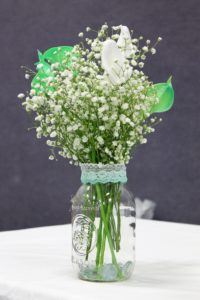 My daughter was married in high school. We had very little time to plan her wedding. We were able to use artificial flowers we purchased online to create simple, but elegant, floral arrangements.
