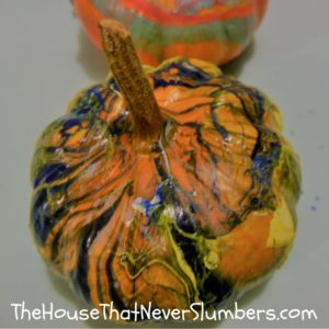 Anyone can make these simple DIY Dipped Pumpkins! This fun fall craft would make a nice addition to your Thanksgiving display or other autumn decorations. Dipping pumpkins takes less time and leaves less mess than traditional pumpkin carving activities, and these DIY Dipped Pumpkins will last longer because you aren't cutting into the pumpkin.