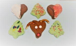 Reindeer Spritz Cookie Recipe - These cute Rudolph cookies will bring a smile to young and old at your next holiday gathering! Reindeer Spritz Cookies are made using a cookie press. Spritz is traditionally a German butter cookie or biscuit formed by squirting the dough through a shaped disc with a cookie press. Kids absolutely love to use a cookie press.