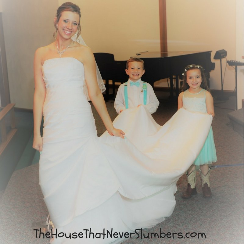 How to Find the Perfect Cheap Wedding Dress - Bride with flower girl and ring bearer