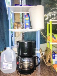 4 Camping Hacks from a Clueless Camper - Make your next camping trip your best ever with these simple camper hacks and tips! Whether you're a newbie camper or a longtime veteran in an RV, you don't want to miss these ideas for camper organization. #camping #campinghacks #camper #offgrid #popupcamper #RV #campground #travel