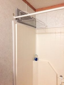 This easy shower shelf is the best solution for drying swimsuits without a mess this summer. #pool #swimmingpool #swimsuits #showershelf #bathroom #momhacks #summervacation