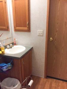 before photo of my small bathroom before I refinished the cabinets to grey with white marble countertops