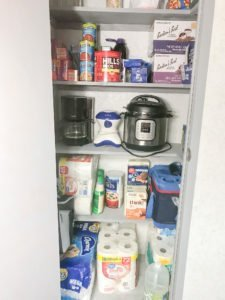 Coat Closet to Pantry Makeover After Shelves Stocked